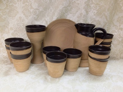 photo of plain rustic lord's supper chalice, paten, flagon, cups made by Debra Ocepek of Ocepek Pottery